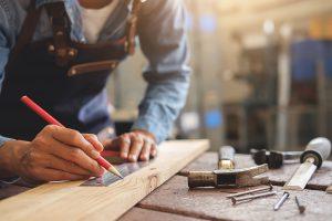 Man in  workshop doing woodwork