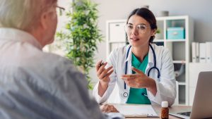 Older man talking with doctor about health