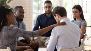 Grief support group with five people