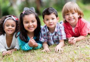 Group of four children smiling at the camera