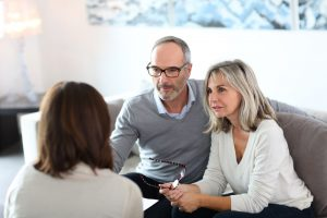 Husband and wife talking to estate planning expert