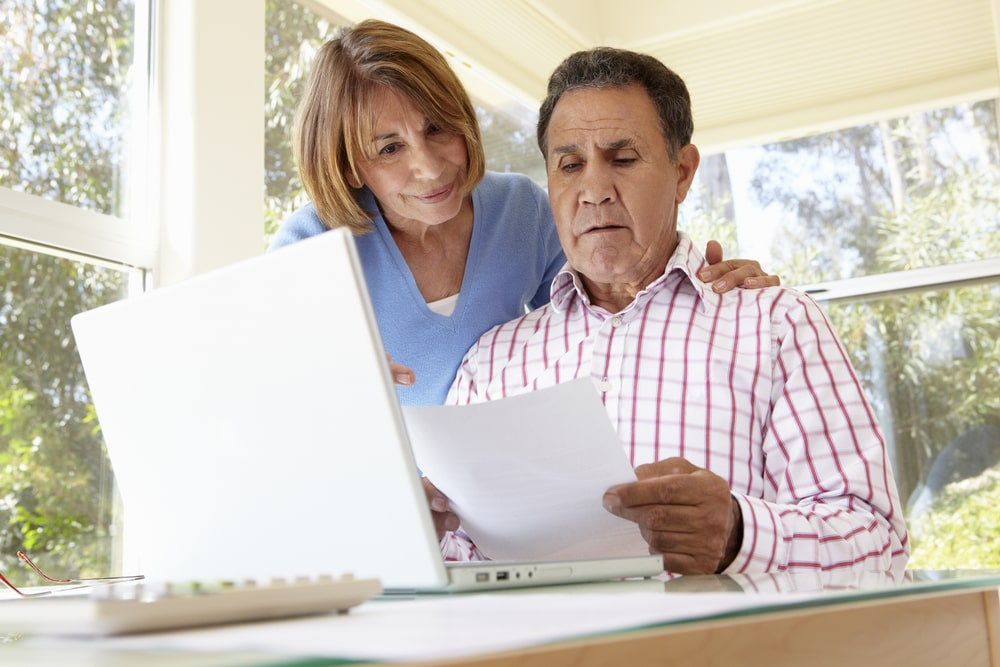 Middle-aged couple looking at documents