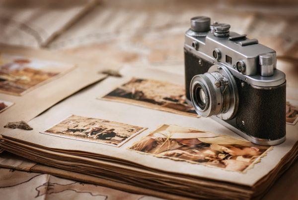Camera sitting on top of photo album