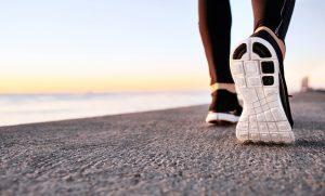 Person walking along the beach, transformation