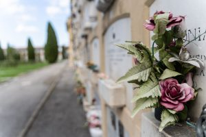 Columbarium wall with plaques and flowers