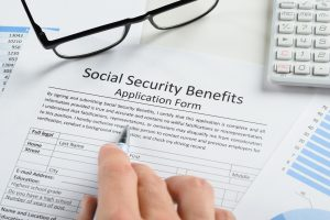 Person filling out Social Security Benefits Application Form