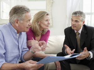 To show a couple discussing plans with a funeral director