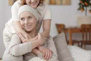 Shows patient receiving hug from caregiver